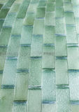 Glass brick rectangular light green. Wall made by semi trasparent glass bricks green color Royalty Free Stock Images