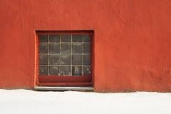 Glass brick square window in red plastered wall with copyspace. Horizontal Royalty Free Stock Photo
