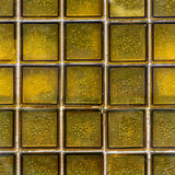 Glass brick tile texture yellow mosaic of wall squares background Royalty Free Stock Image