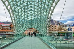 Glass Bridge of Peace across the Kura River in Europe Square, Tbilisi. Georgia. royalty free stock photography