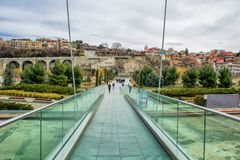 Glass Bridge of Peace across the Kura River in Europe Square, Tbilisi. Georgia. royalty free stock image