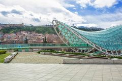 Glass Bridge of Peace across the Kura River in Europe Square, Tbilisi. Georgia. stock image