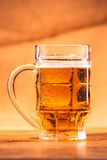 Glass bright beer mug on a blurred background Stock Photo