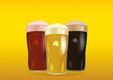 A glass with bright, red and dark beer. Invitation to the St. Patrick day Royalty Free Stock Photography