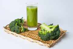 Glass of broccoli extract. On a tray stock image