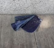 Glass broken car pulled to the floor. Glass with dark label and anti-splinter, automobile insurance coverage, insecurity problem, caused by the crime and royalty free stock photography