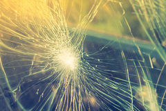 Glass broken cracks splinters in front of car . ( Filtered image Royalty Free Stock Photography