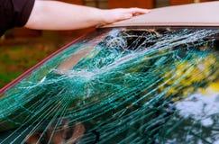 Glass broken cracks splinters in front of car. Front window accident windscreen crash cracked transparent vandalism windshield shattered wreck destruction stock image