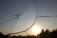 Glass  broken  window  sunset Royalty Free Stock Photo