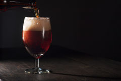 Glass of brown beer Stock Images