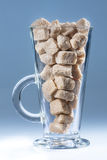 Glass of brown sugar Stock Image