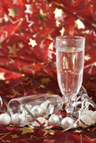 Glass with bubbles. Christmas decorations with champagne glass filled with bubbles Royalty Free Stock Photography