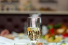 Glass with bubbly champagne in weddind. Wedding details in close-up view.  stock photo