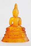 Glass Buddha statue. Orange glass Buddha statue on white background Royalty Free Stock Photo