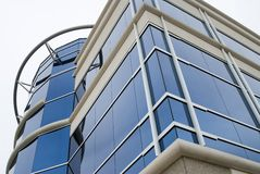 Glass building. Detail of tall mostly building,lots of glass windows in blue colors Stock Photos