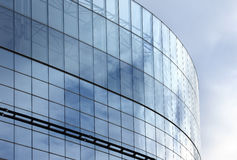Glass building. Modern building with mirror over sky Royalty Free Stock Image