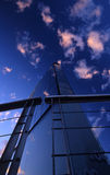 Glass building. A glass building with a impressive sky Royalty Free Stock Photography