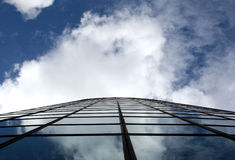 Glass Building. Side of building and cloud reflections stock images