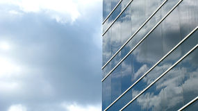 Glass building. The exterior glass of a skyscraper reflecting the cloudy sky royalty free stock photography