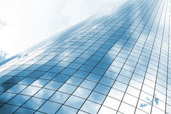 Glass building. Highrise glass building with skz and clouds reflection Royalty Free Stock Images