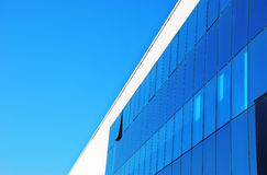 Glass building. Blue tall building with sky in reflexion Stock Image