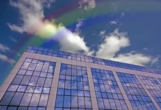 Glass Building Against A Blue Sky With Rainbow Stock Photos