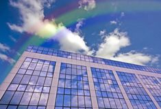 Glass building against a blue sky with rainbow Stock Photography