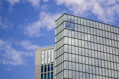 Glass building against sky. Low angle view of a glass building against the sky Royalty Free Stock Photo