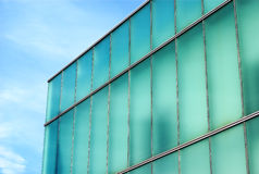 Glass building aqua and blue, office place perspective corner. Office building glass architecture light green and blue corner and sky business place of work stock image