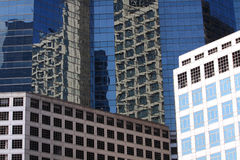 Glass building background. New office building in business center with reflection in glass wall Stock Image