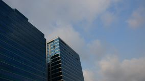 Glass building with blue sky, Timelapse stock footage
