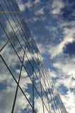 Glass Building for Business Reflection of Blue Sky and Clouds Royalty Free Stock Image