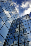 Glass Building for Business Reflection of Blue Sky and Clouds Stock Photography