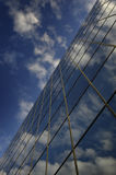 Glass Building for Business Reflection of Blue Sky and Clouds Stock Photos
