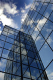 Glass Building for Business Reflection of Blue Sky and Clouds Stock Image