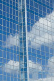 Glass building with cloud reflections Stock Photos