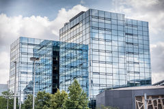 Glass building with clouds reflection. In Germany Stock Photos