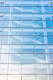 Glass building exterior with staircase behind glass facade Stock Photography