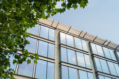 Glass building. Glass facade of a modern building on sunny day stock photography