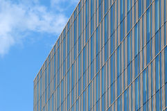 Glass building with golden stripes royalty free stock images