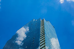 Glass Building. High rise glass building with the reflection of the sky and clouds Stock Photography