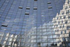 Glass building - La Defense. Corporate glass building with open windows - La Defense, Paris Royalty Free Stock Image