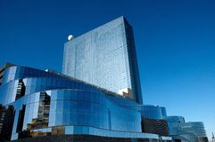 Glass building reflecting blue sky Stock Photos