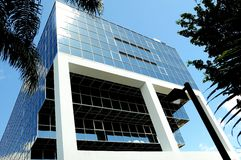Glass building reflecting blue sky Stock Images