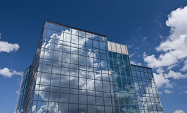 Glass building reflecting sky Royalty Free Stock Photos