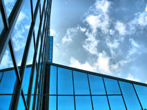 Glass building reflecting sky Stock Photos