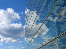 Glass Building reflection. Glass building cloud reflections in Helsinki Royalty Free Stock Image