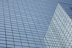 Glass building reflections. Glass building in the city center with its corner reflections royalty free stock photo
