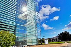Glass building with sky Stock Photos