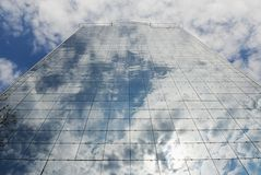 Glass-building, sky and clouds Royalty Free Stock Photography